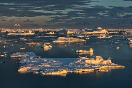 Sea-ice-floating-against-far-mountains-in-late-light_S6A8906-Graham-Coast-Antarctica.jpg
