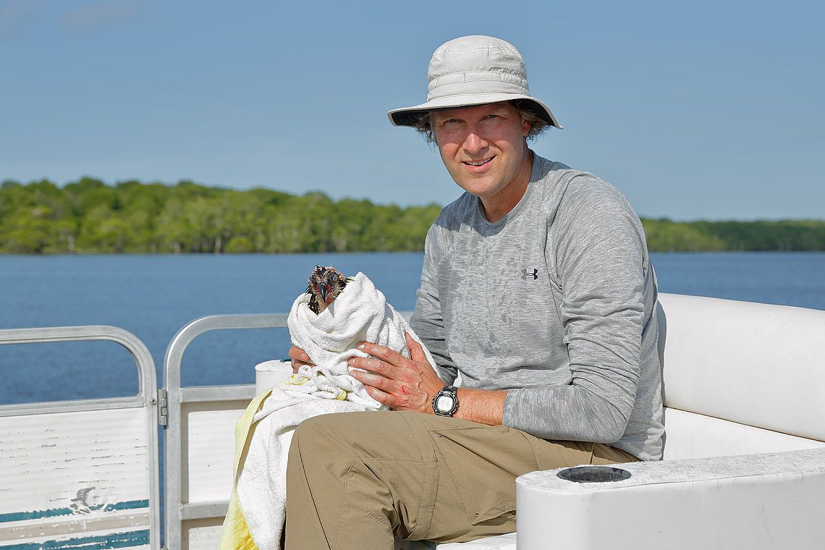 clemens-with-saved-osprey-in-towel_s6a7035-lake-blue-cypress-fl-usa.jpg