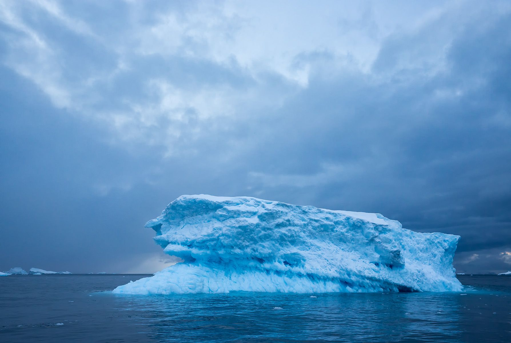 Ice berg shape with dark clouds_S6A5286-Cierva Cove, Hughes Bay, Antarctica.jpg