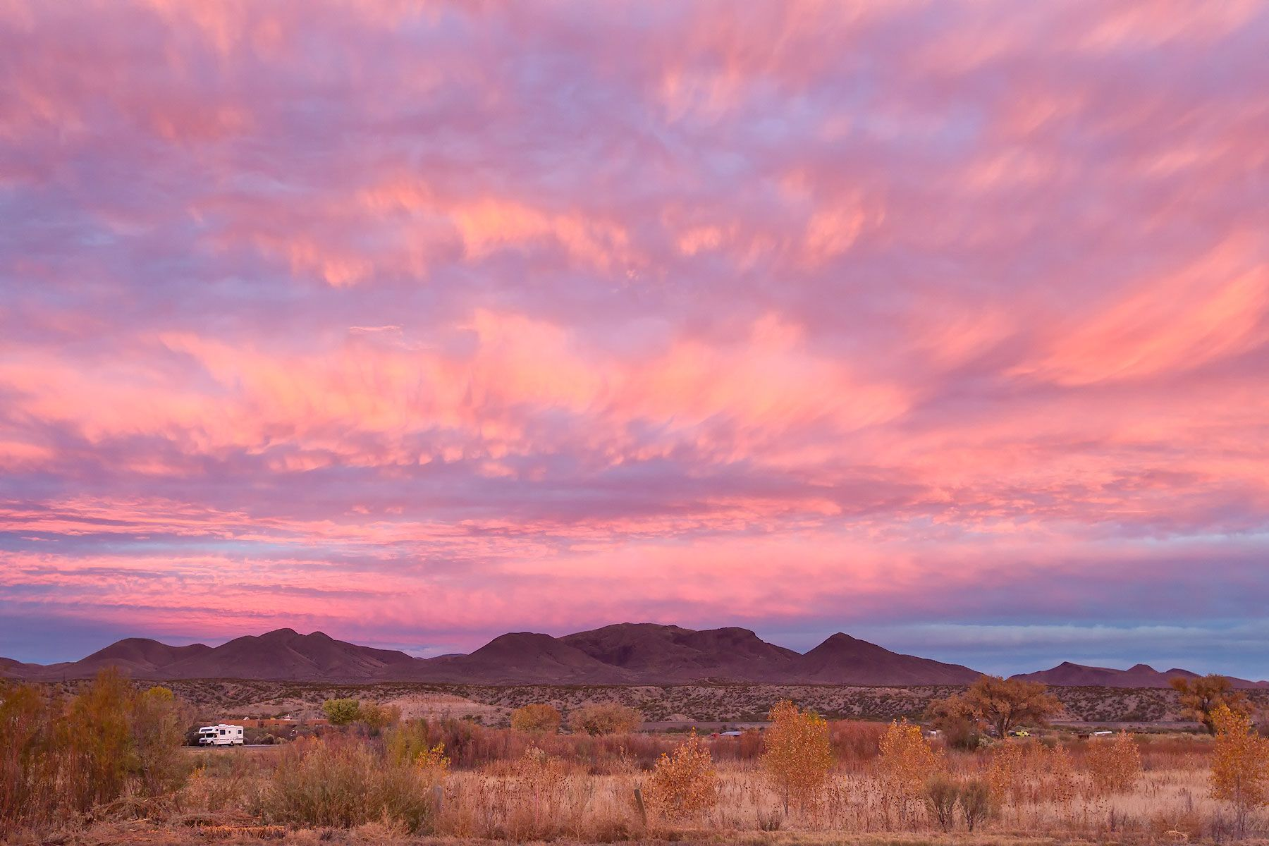 Pink-morning-sky-above-the-mountains-23100041-Bosque-del-Apache-NWR,-San-Antonio,-NM.jpg