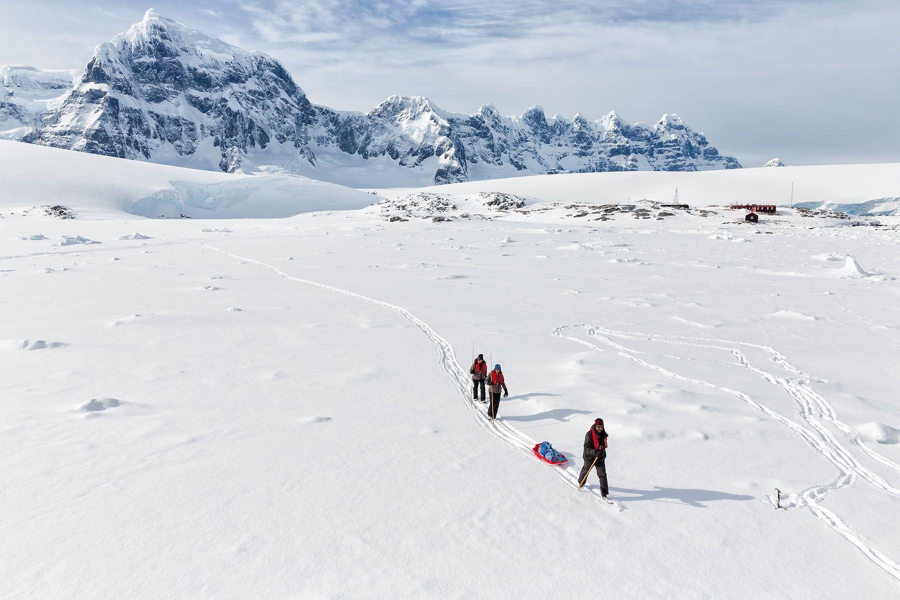 Trekkers-hiking-over-sea-ice_S6A0433-Port-Lockroy,-Antarctica.jpg