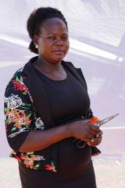 Ajok Pauline (age 35)  seamstress at  Amani Ya Ju.