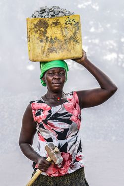 Jennider Abu (age 40)  working in quarry for 9 years breaking stones to create gravel. Earns 1,000 shillings ($0.32 USD) per Jerrycan of gravel. Earns 10,000 to 13,000 shillings per day.