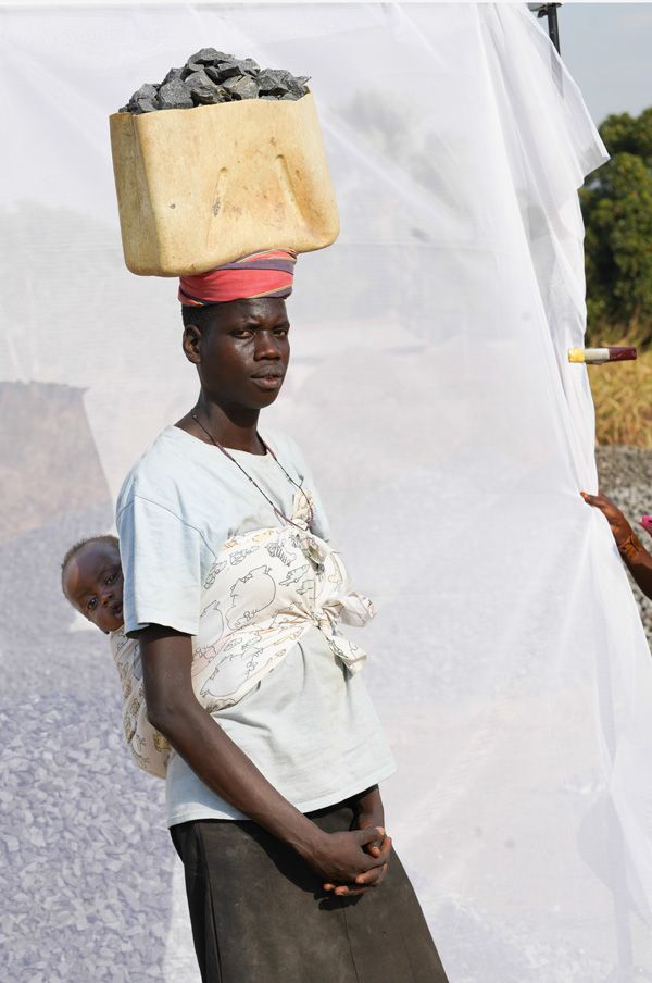 Quarry worker with her baby