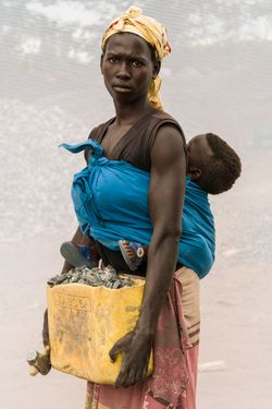 Aciro Vicky (age 18 ) with her son Michael (age 10 months)  working in quarry for one year.
