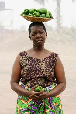 Acan Rose (age 51) sells vegetables at Layibi Market for three years.