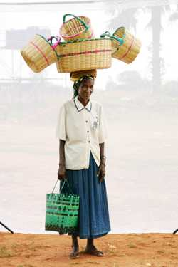 Anteko Christine (age 50) selling local  woven baskets for 20 years.