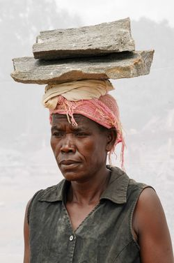 Alica Acan (age 40) working in quarry for seven years.
