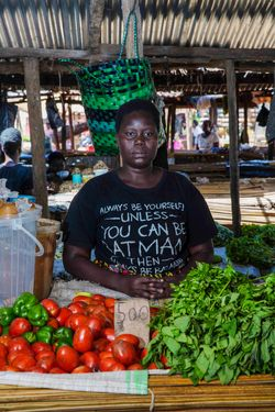 Ocwee Pamela (age31) sells vegetables at Layibi market.