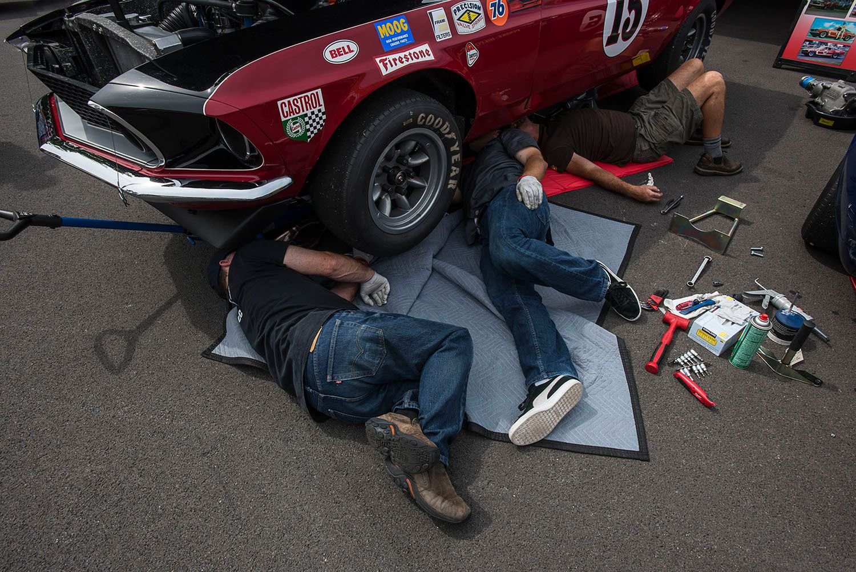 Pit Crew Repairing Race Car