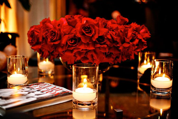 Velvet roses low centerpiece with surrounding candlelights.