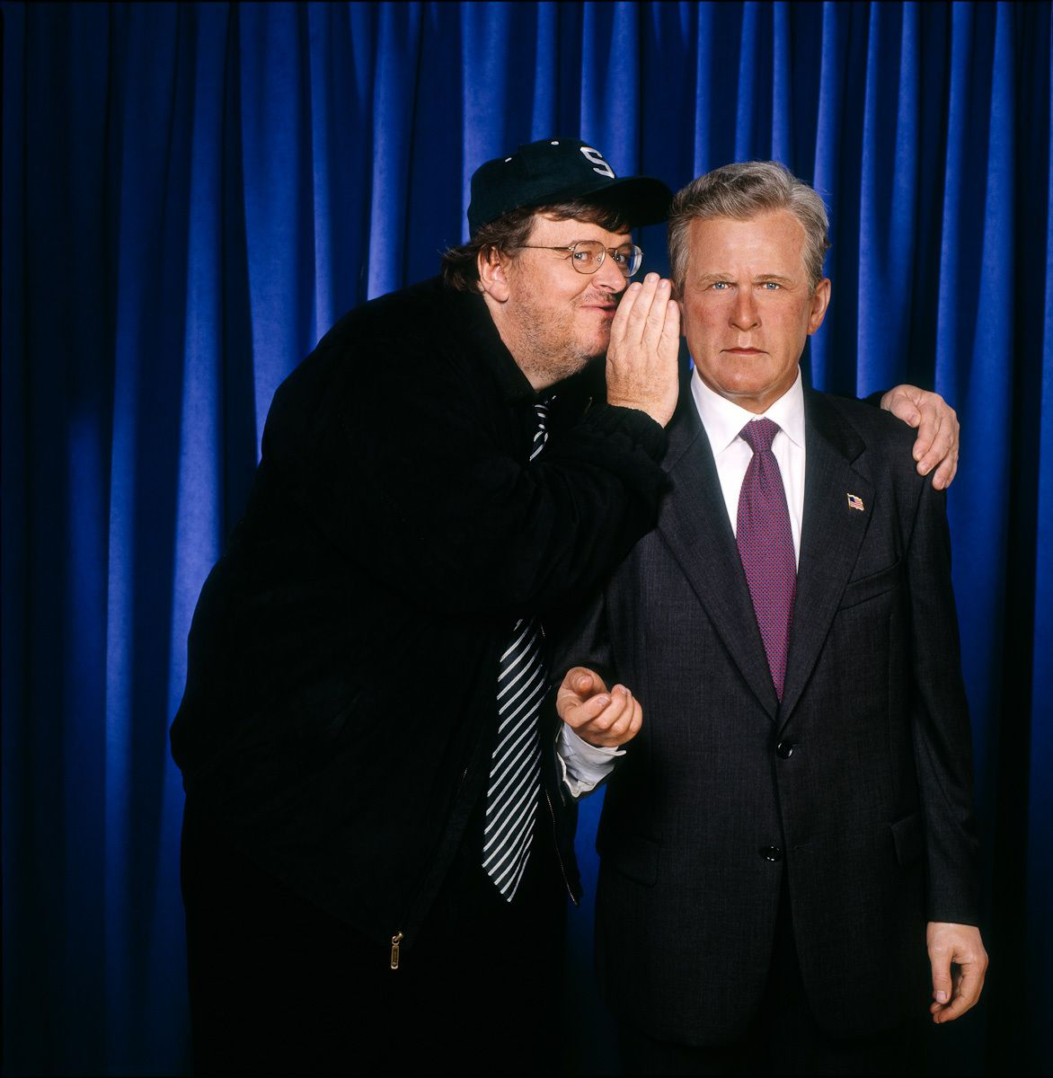 MIchael Moore, documentary filmmaker, and dummy
