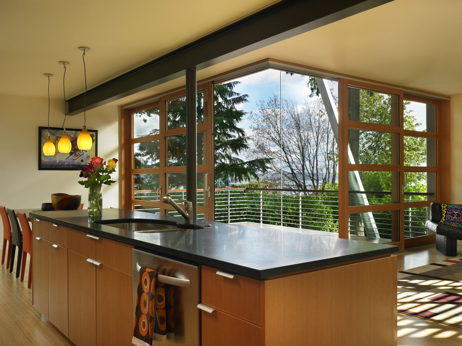 Fir lift & slide doors open the dining and living space to the covered deck thereby doubling the entertaining space.