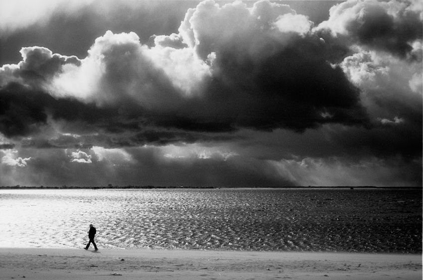 1man_walking_on_beach_storm_.jpg