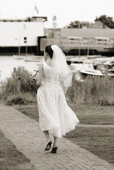 Bride walking down cobblestone path
