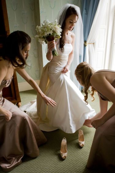 Bride's Maids helping her get ready for her big day!