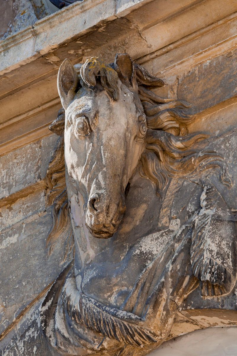 CHAMPLATREUX, HORSE SCULPTURE OVER STABLES ENTRANCE