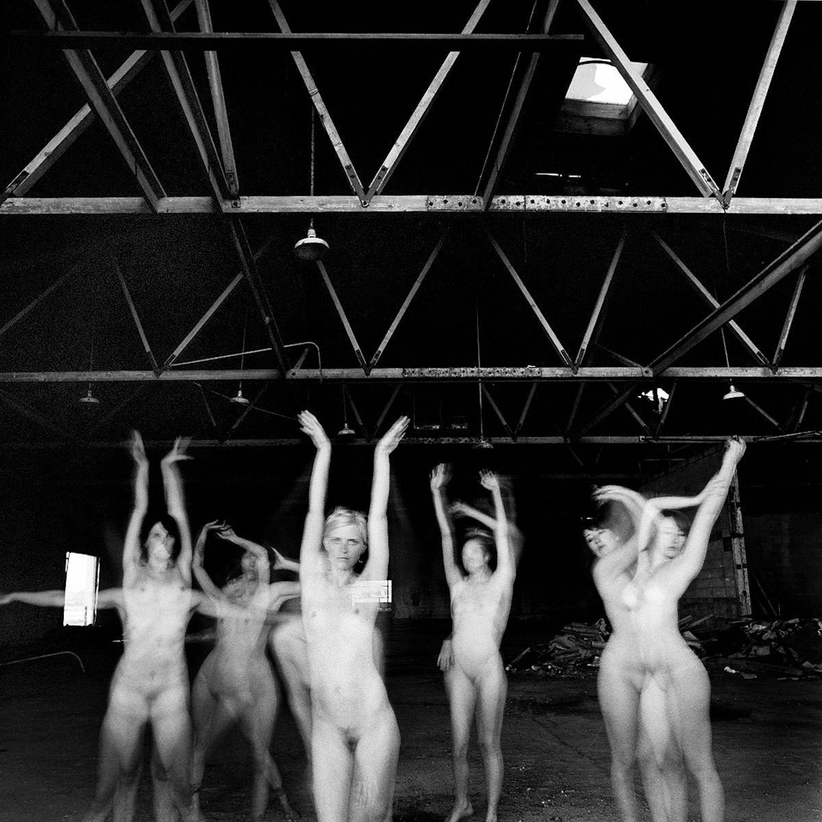 1girls_arms_up_warehouse