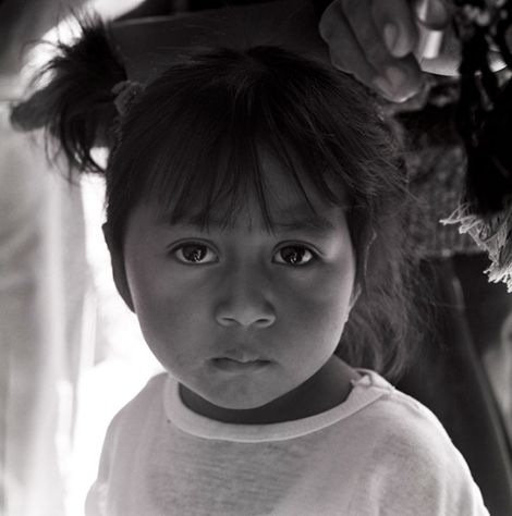 Nina in father's shadow, San Francisco, Guatemala