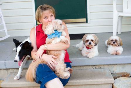 With her rescue dogs