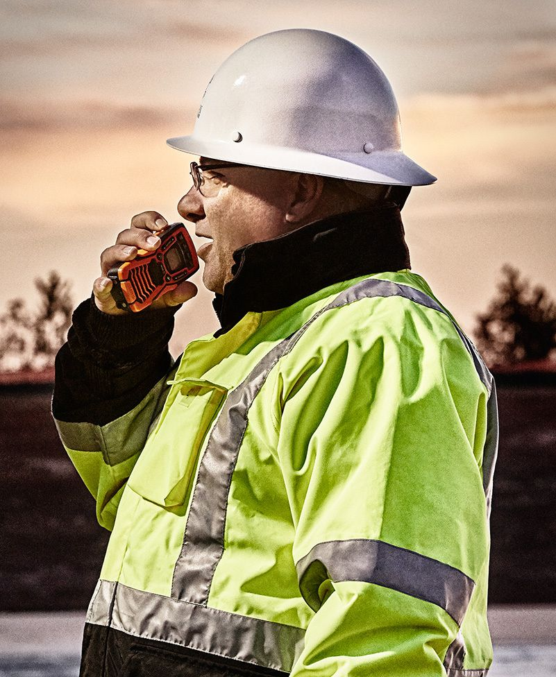 1people_working_man_foreman_hardhat_walkietalkie_location_outdoors