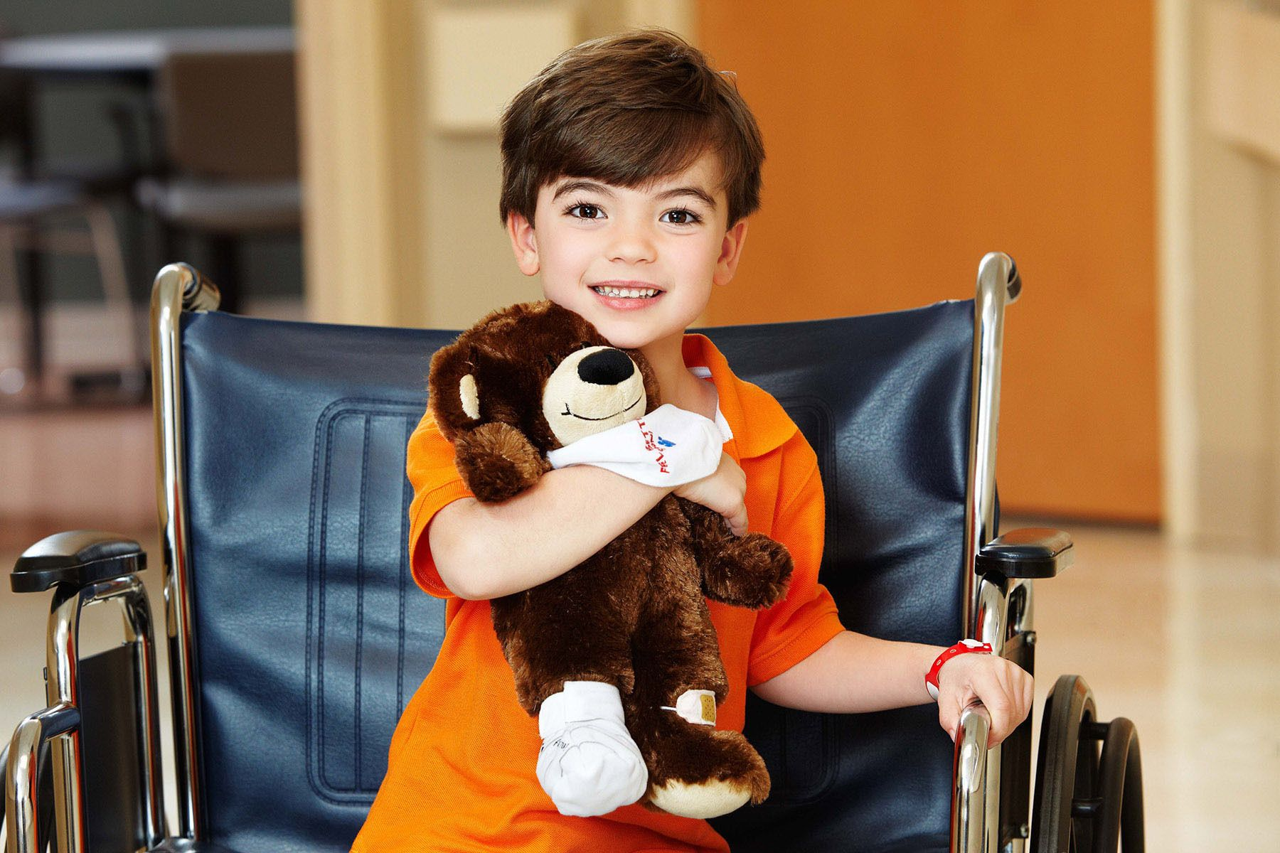 1lifestyle_location_boy_teddy_bear_wheelchair_hospital