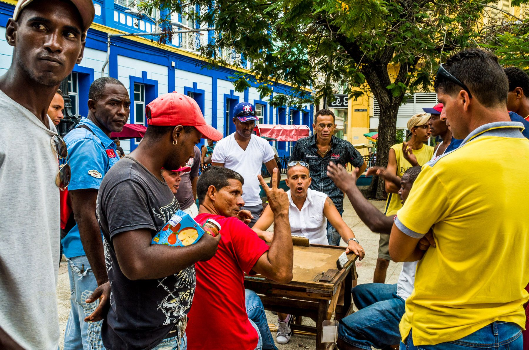 A fiesty game of dominoes on the plaza in Santiago de Cuba.