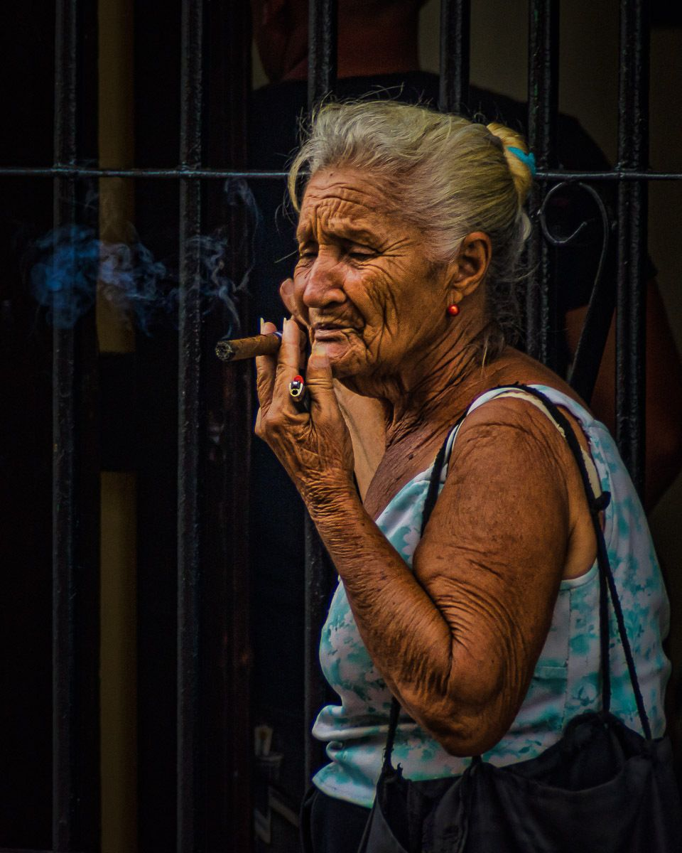 Cuban woman smoking cigar in Santiago de Cuba.