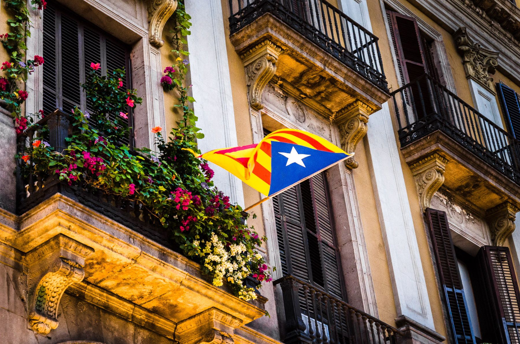 Catalon flag of succession in Plaza of the Lights.  Barcelona, Spain