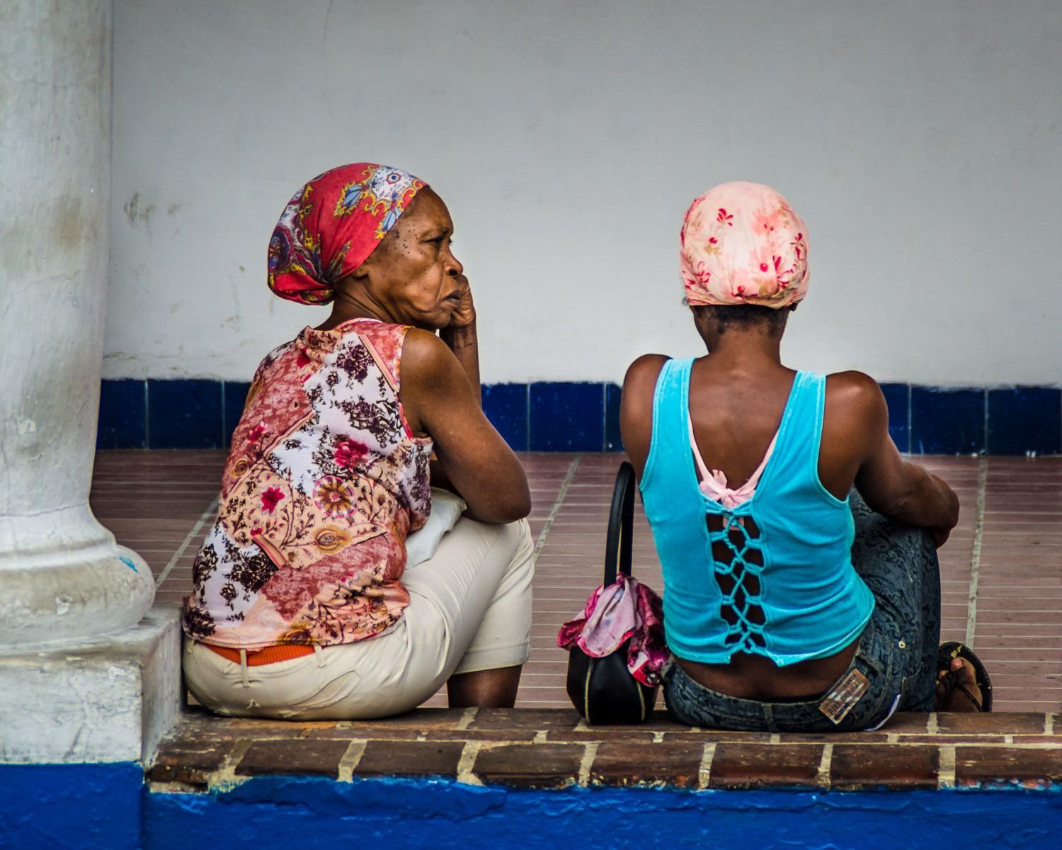 Cuban women waiting outside government building in Santiago de Cuba.