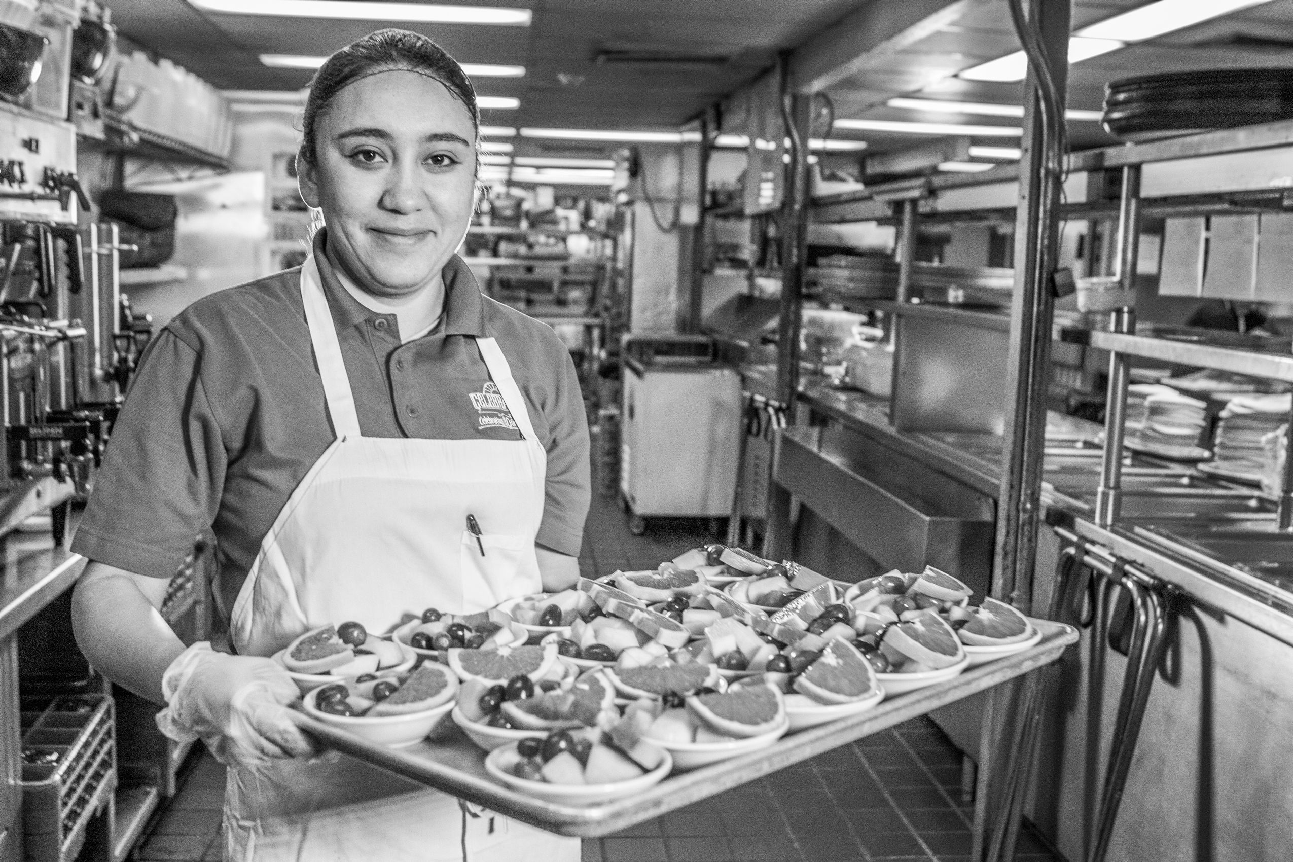 Kitchen employee with deserts .jpg