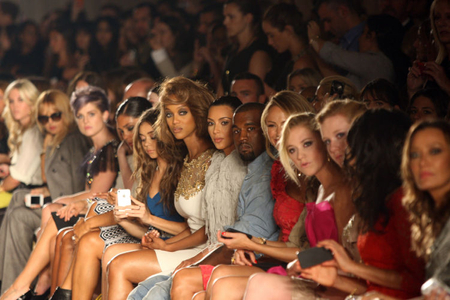 (L - R) Tyra Banks, Kim Kardashian and Kanye West attend the Marchesa show during Spring 2013 Mercedes-Benz Fashion Week at Grand Central Terminal on September 12, 2012 in New York City.  (Photo by Bennett Raglin)
