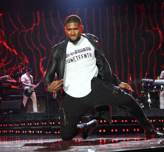 Usher performs during the 2015 Essence Festival, New Orleans, LA.(Photo by Bennett Raglin)