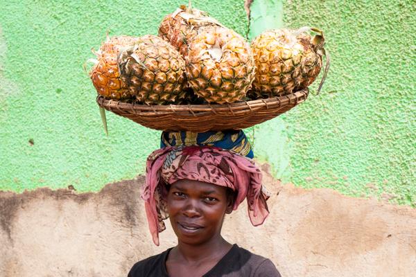 rwanda_woman_kigali_carrying_pineapples.jpg