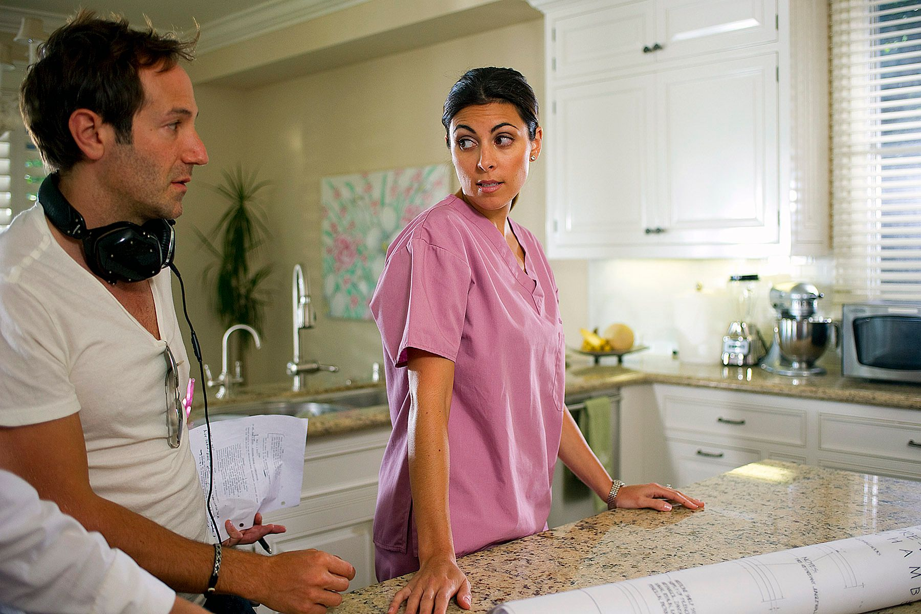 Director Bryan Fogel instructs Jamie Lynn Sigler in a scene during the filming of Jewtopia.