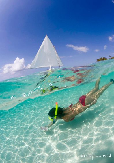 Over/under of Snorkeler at Seven Mile Beach, Grand Cayman