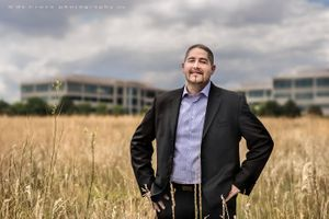 Portrait Executive Photography In Field Near Office