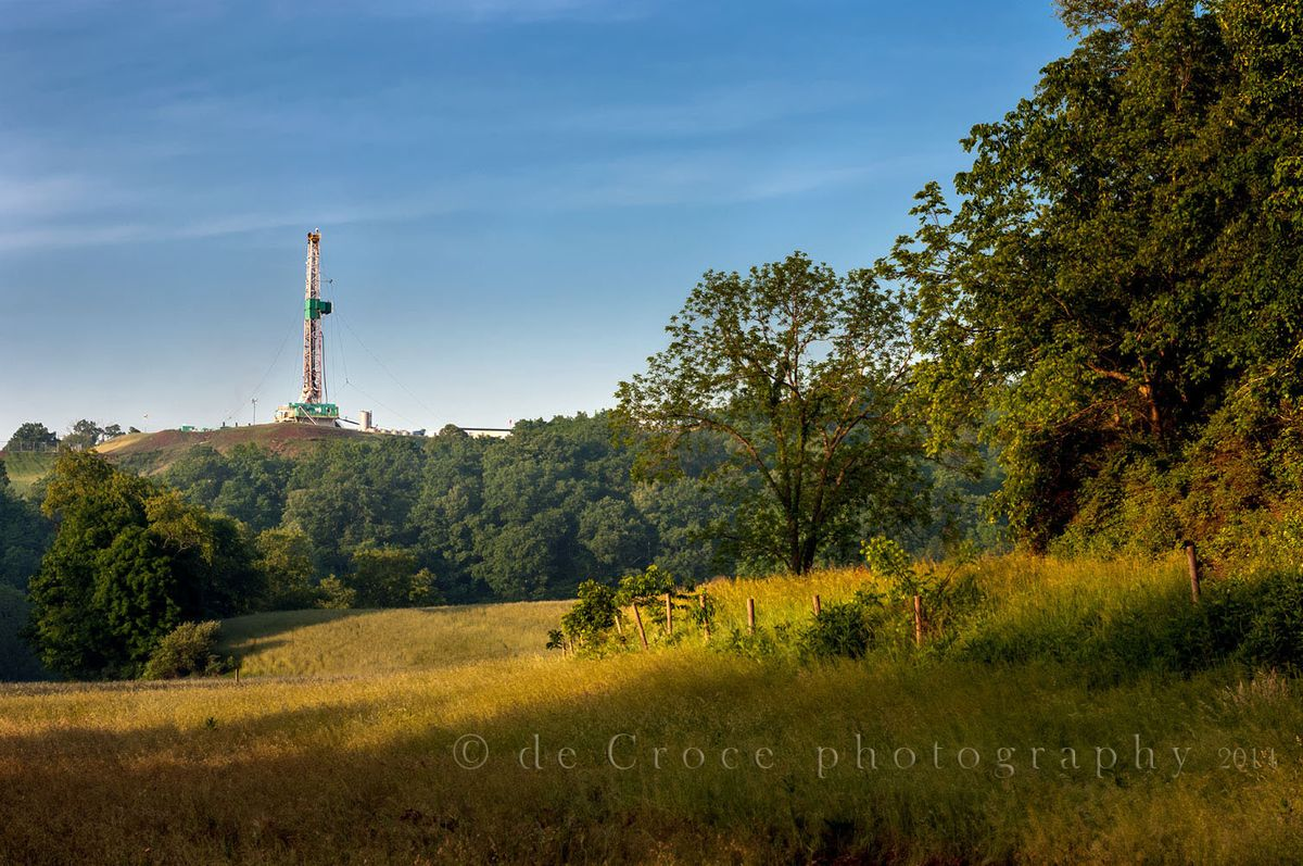 Oil derrick in field