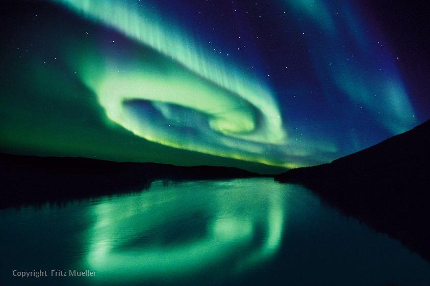 Aurora borealis reflected in the Stewart River, Yukon