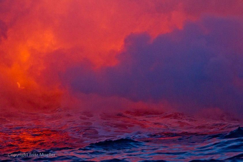 Lava flows into the ocean on the Puna Coastline, Hawaii Volcanoes National Park, Big Island of Hawaii