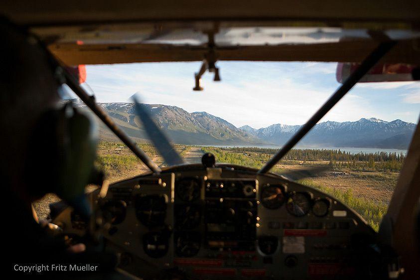 Helio Courier takes off from airstrip at Kluane Lake, Yukon