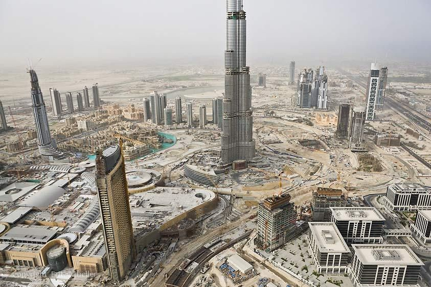 The world's tallest building, the Burj Dubai, and world's largest mall, Dubai Mall, under construction in Dubai, United Arab Emirates