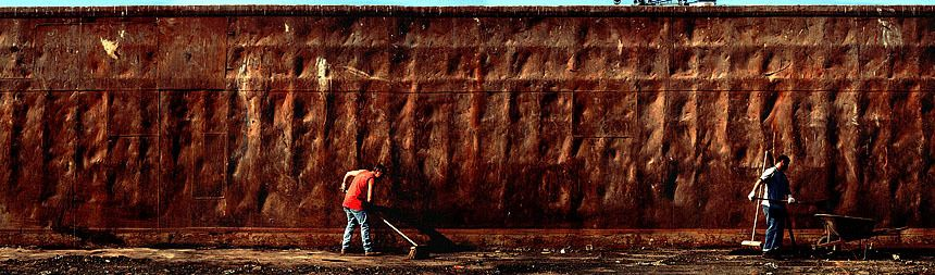 NYC Sanitation workers scrub clean garbage barges as part of the closing of Fresh Kills Landfill.