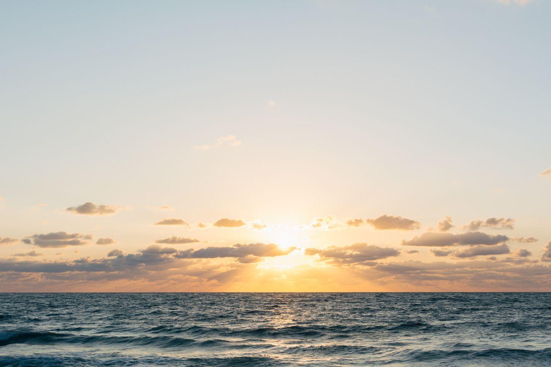 Dawn over calm ocean