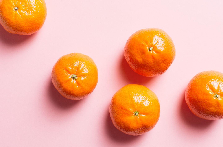 Still life Mandarin oranges on pink surface