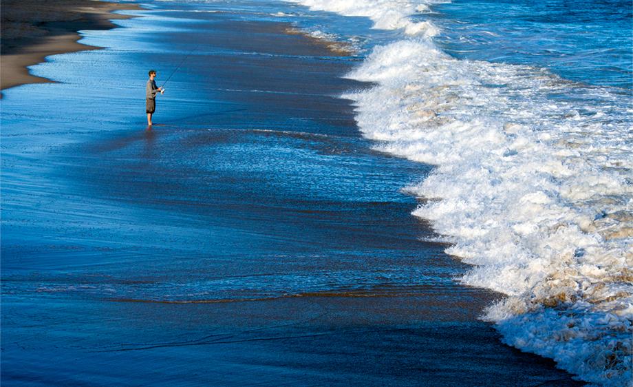 A fishermen on the beach in Watch Hill, Rhode Island.