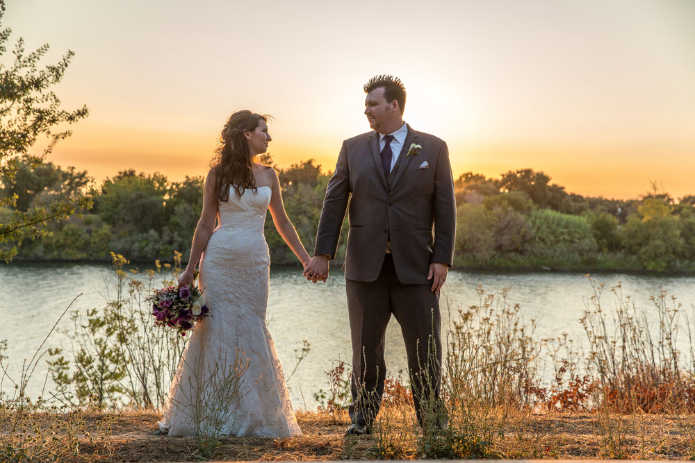 Delta bride and groom at sunset
