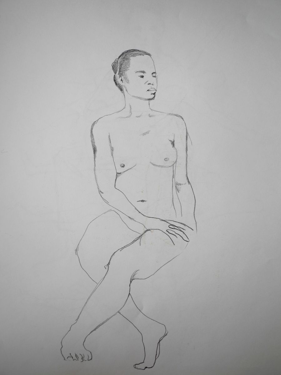 SEATED WOMAN WITH LEGS CROSSED AT KNEES