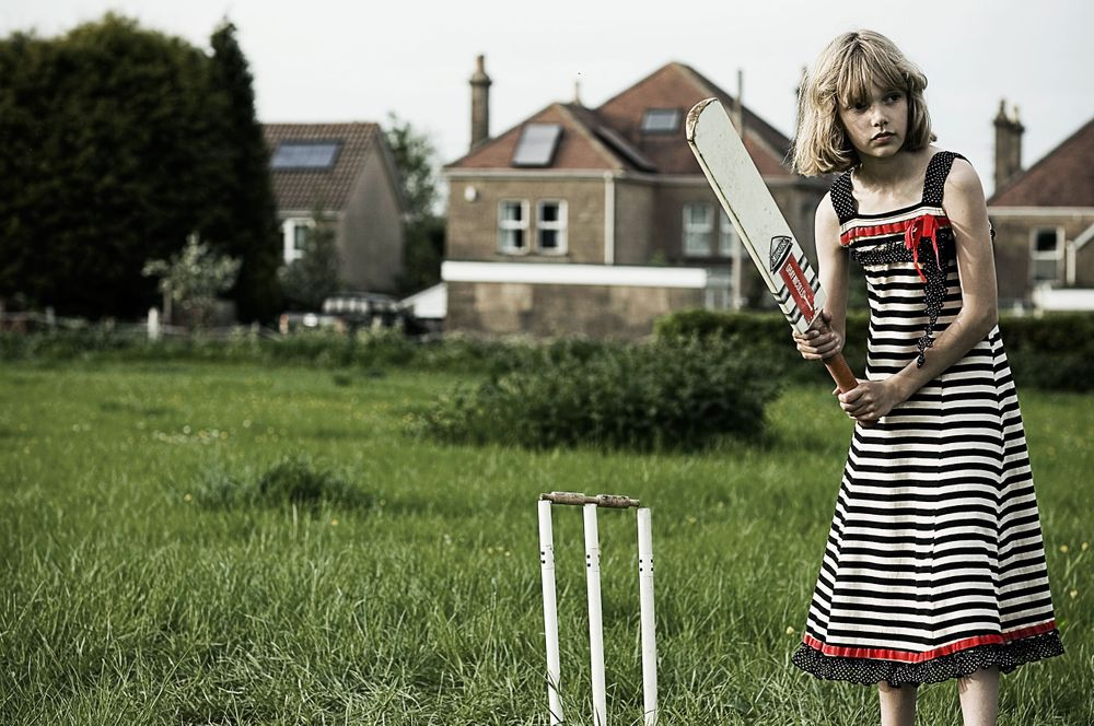 Girl playing Cricket on her Mums wedding Day