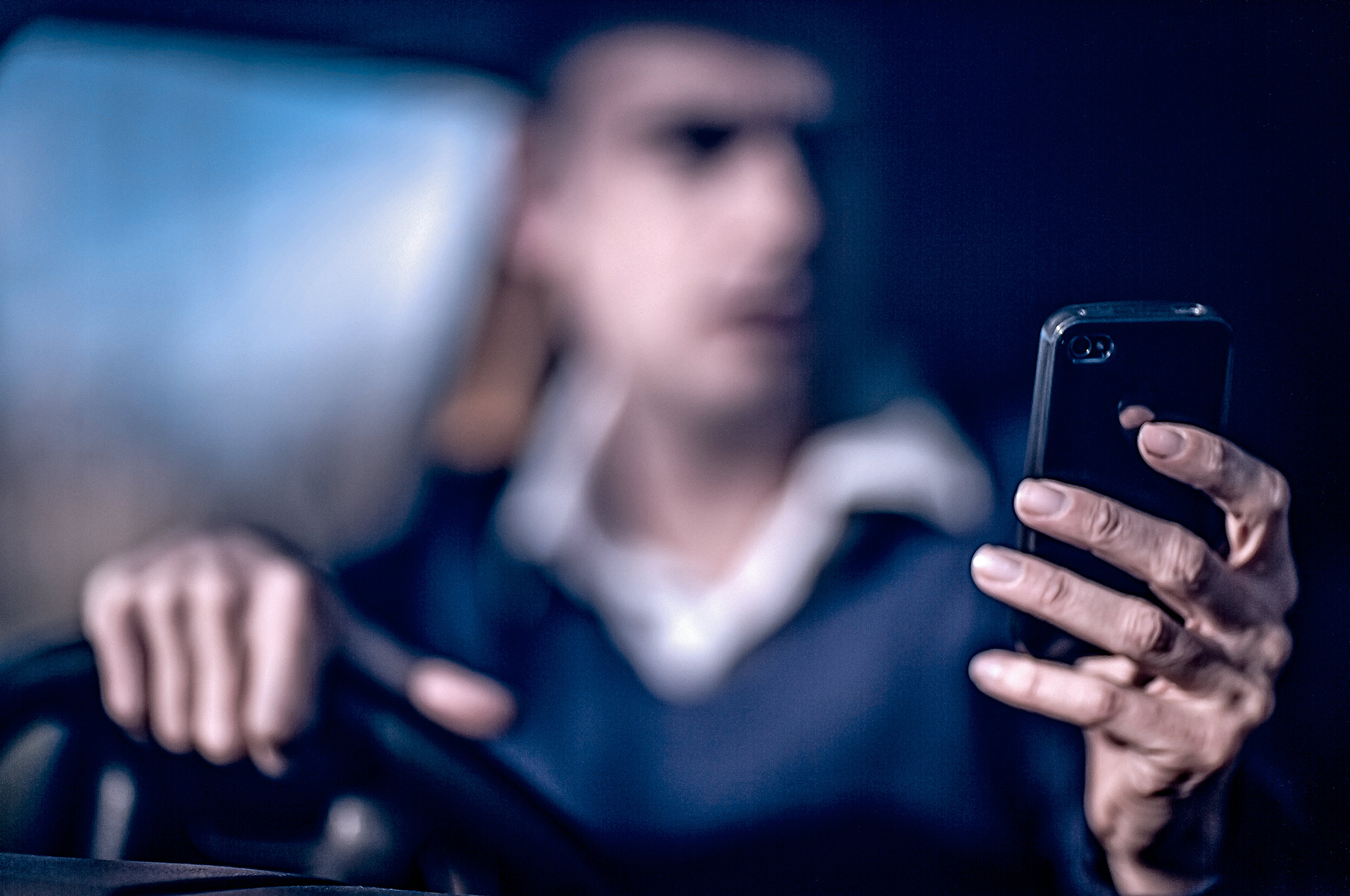 Driving-on-the-phone_Stock-Photography.jpg